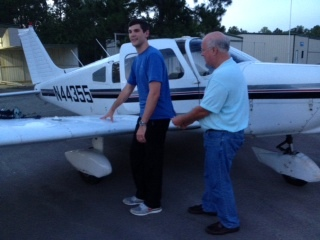 John Jones CFI Cutting a solo shirt for MidCoast Aviation Services